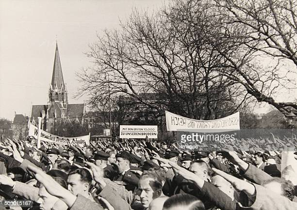 Strength Through Joy-trip to Berlin. Before the departure from Vienna's Westbahnhof Austrian workers are performing the Nazi salute and demonstrating...