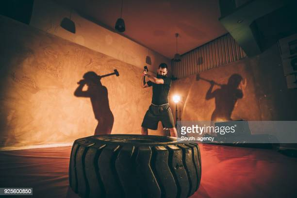 strength training with hammer - south_agency stock pictures, royalty-free photos & images