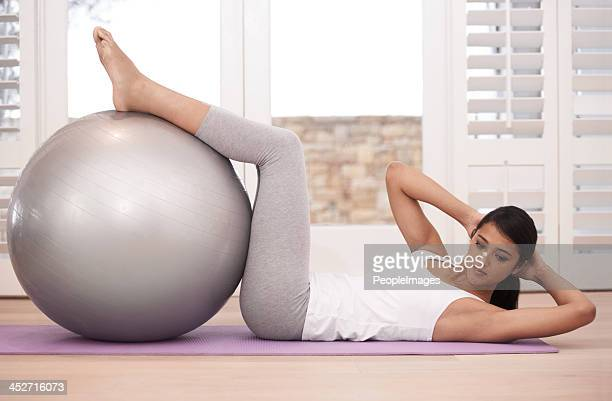 strengthening her core - fitness ball stock pictures, royalty-free photos & images