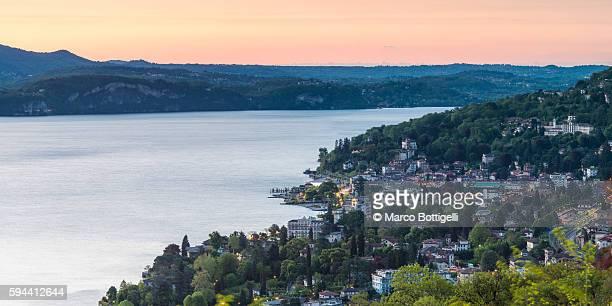 Stresa, Lake Maggiore, Verbano-Cusio-Ossola, Piedmont, Italy. Panoramic view over the lake's coast at dawn.