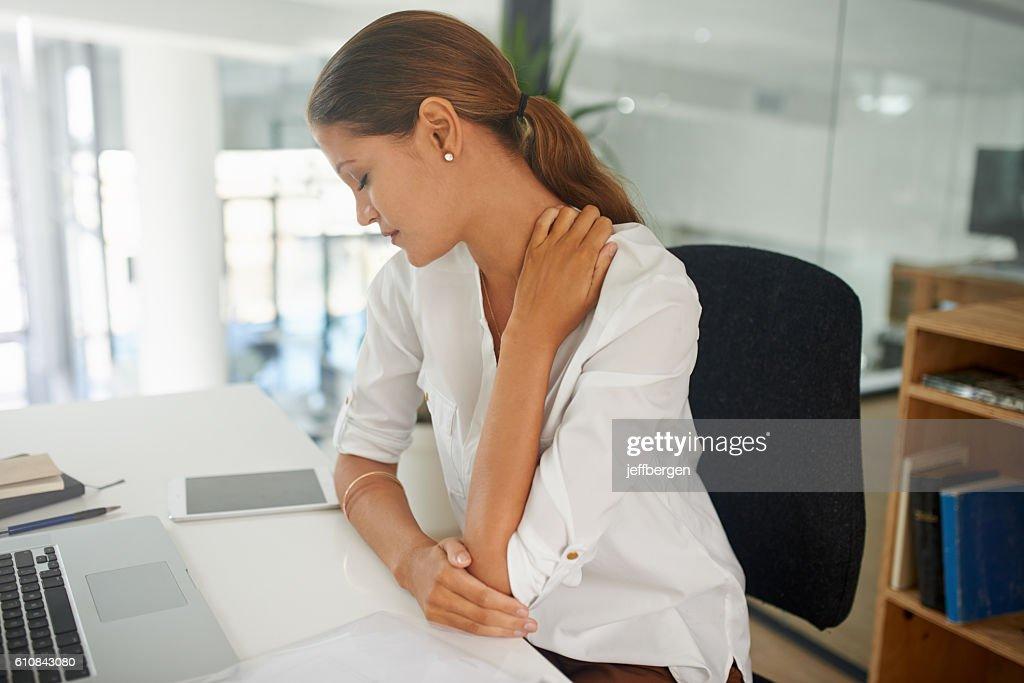 Stress has got her in it's grip : Stock Photo