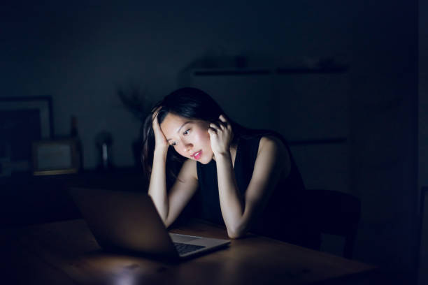 stressed and frustrated businesswoman working on laptop till late at work - low stress stock pictures, royalty-free photos & images