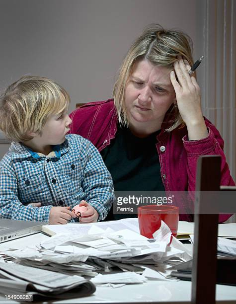 Stressed and tired mother dealing with financial issues
