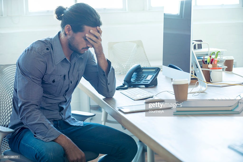 Stressed business man at the office. : Stock Photo