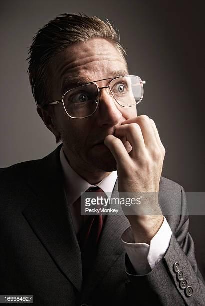 Stressed Businessman Biting Fingernails with Nervous Expression