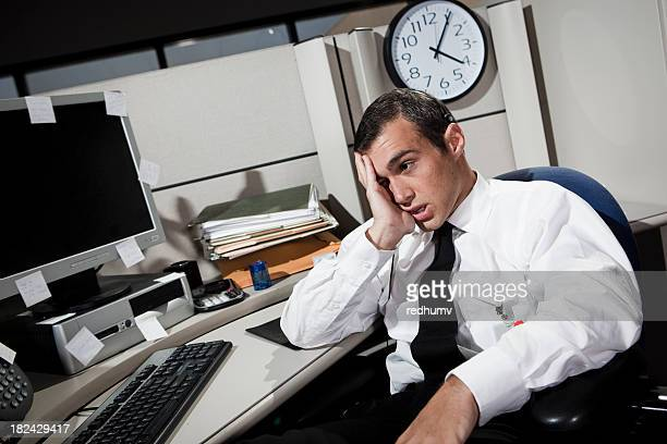 Stressed Businessman in Office Cubicle