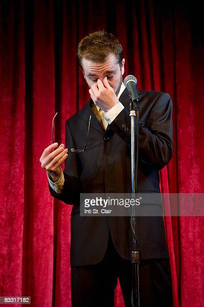 stressed businessman on stage at microphone - あがり症 ストックフォトと画像