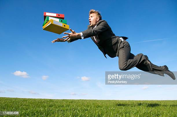 Stressed Businessman Tripping Outdoors Green Meadow for File Folders
