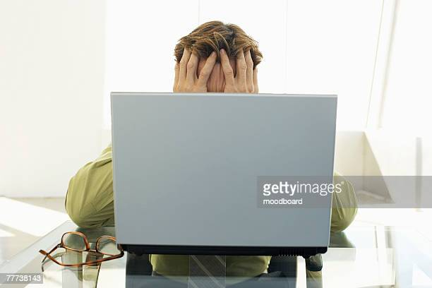 Stressed Businessman Using Laptop