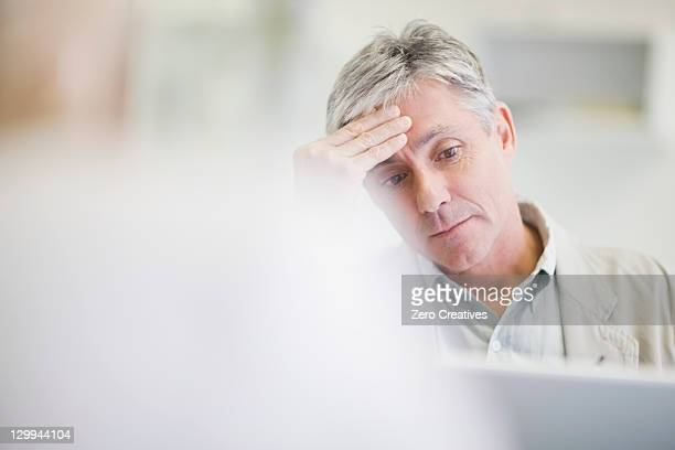 Stressed businessman working in office