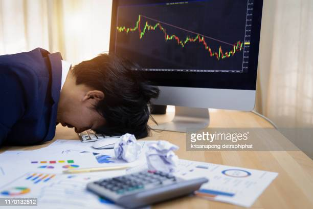 stressed businessmen, stock market investors stressed, stock falls, stock market falls - deterioration stock pictures, royalty-free photos & images