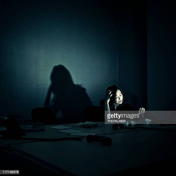 stressed businesswoman alone in her office