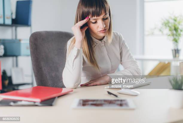 Stressed businesswoman in office