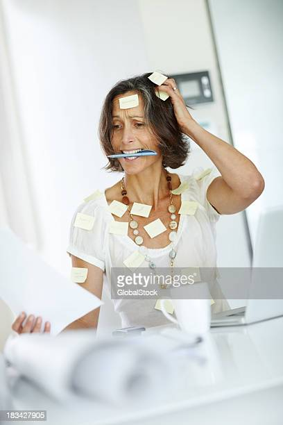 Stressed businesswoman - Woman covered with sticky notes