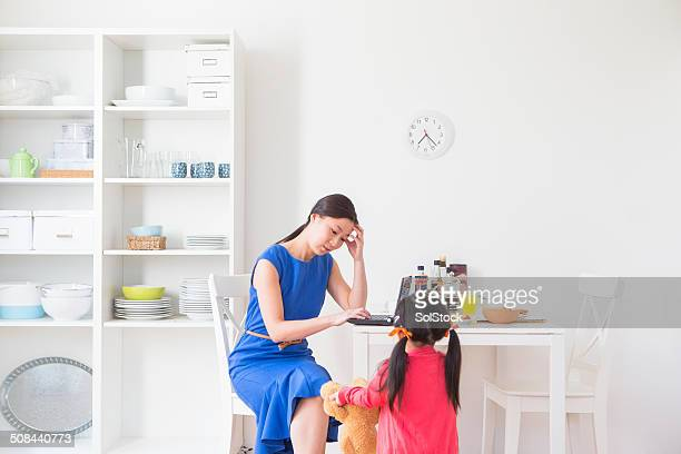 Stressed Chinese Business Woman and Daughter