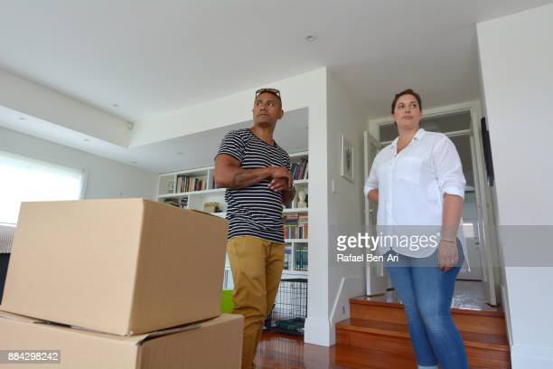 Stressed couple moving out their home