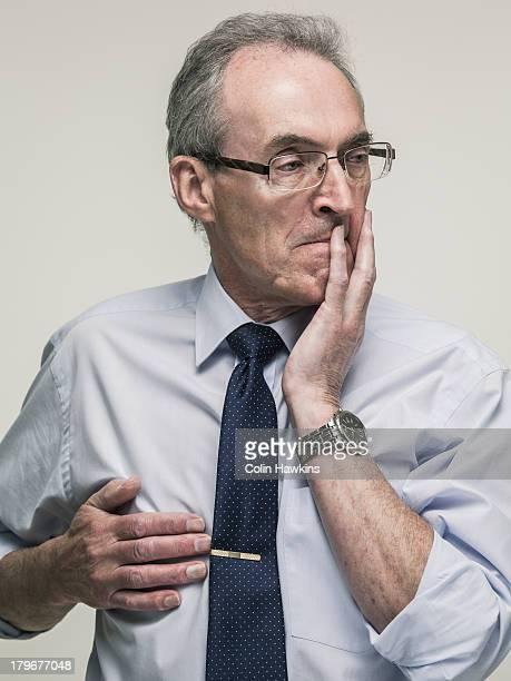 Stressed elderly business man