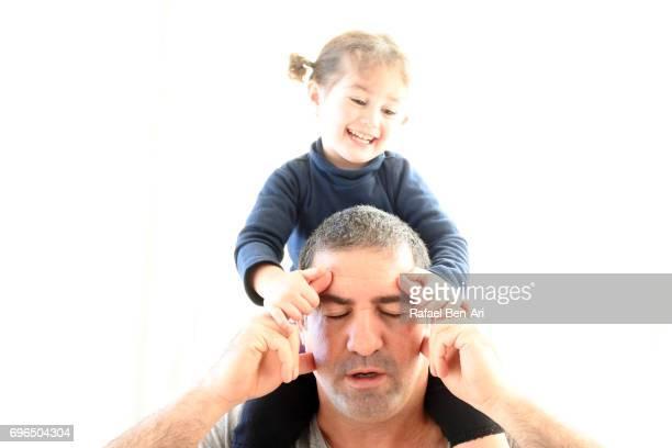 stressed father and cheeky daughter - rafael ben ari bildbanksfoton och bilder