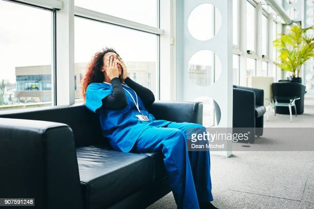 stressed female medical taking break from work - burden stock pictures, royalty-free photos & images