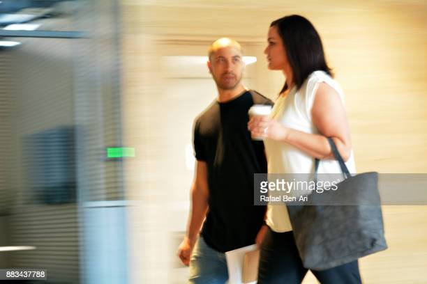 Stressed man looks at his spouse while walking