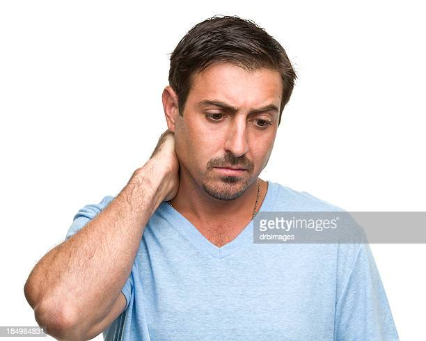 stressed man rubs neck - blame stock pictures, royalty-free photos & images
