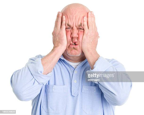 Stressed Man Squishes Face in Hands