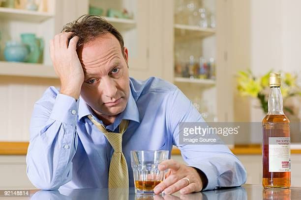 Stressed man with whisky