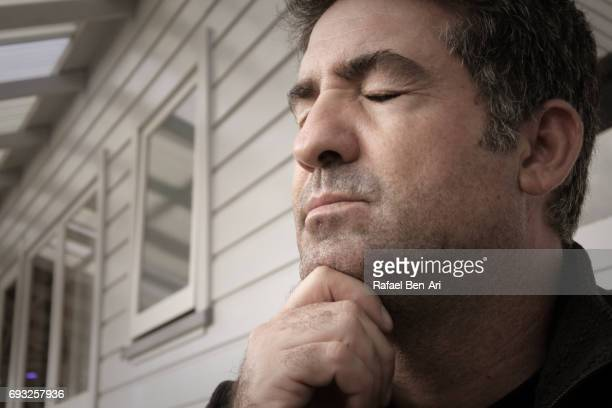 stressed middle aged man - rafael ben ari stock-fotos und bilder
