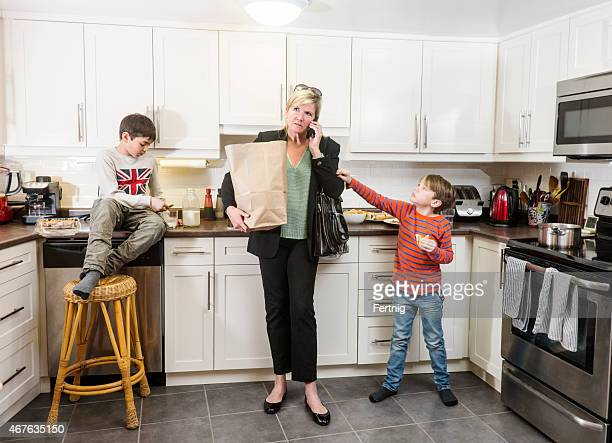 Stressed mother and businesswoman arriving home to her family