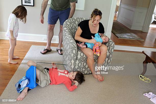 stressed mother and children - lisa strain stock pictures, royalty-free photos & images