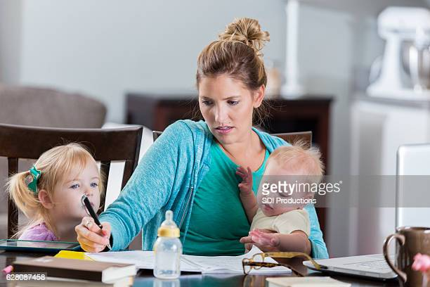 Stressed mother working from home