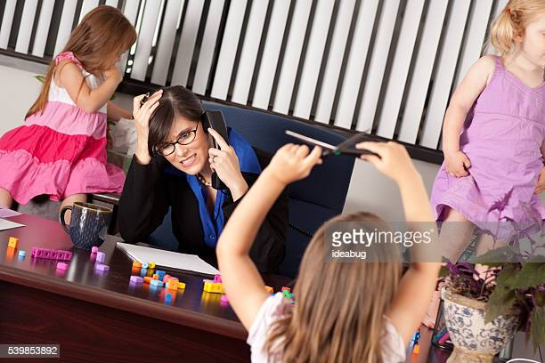 Stressed Out Businesswoman with Children in Office