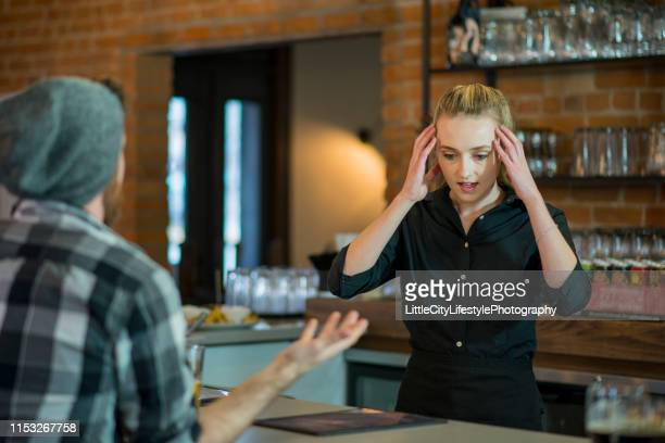 stressed out waitress - cruel stock pictures, royalty-free photos & images