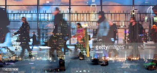 stressed people leaving office, cityscape reflection - middle east stock pictures, royalty-free photos & images