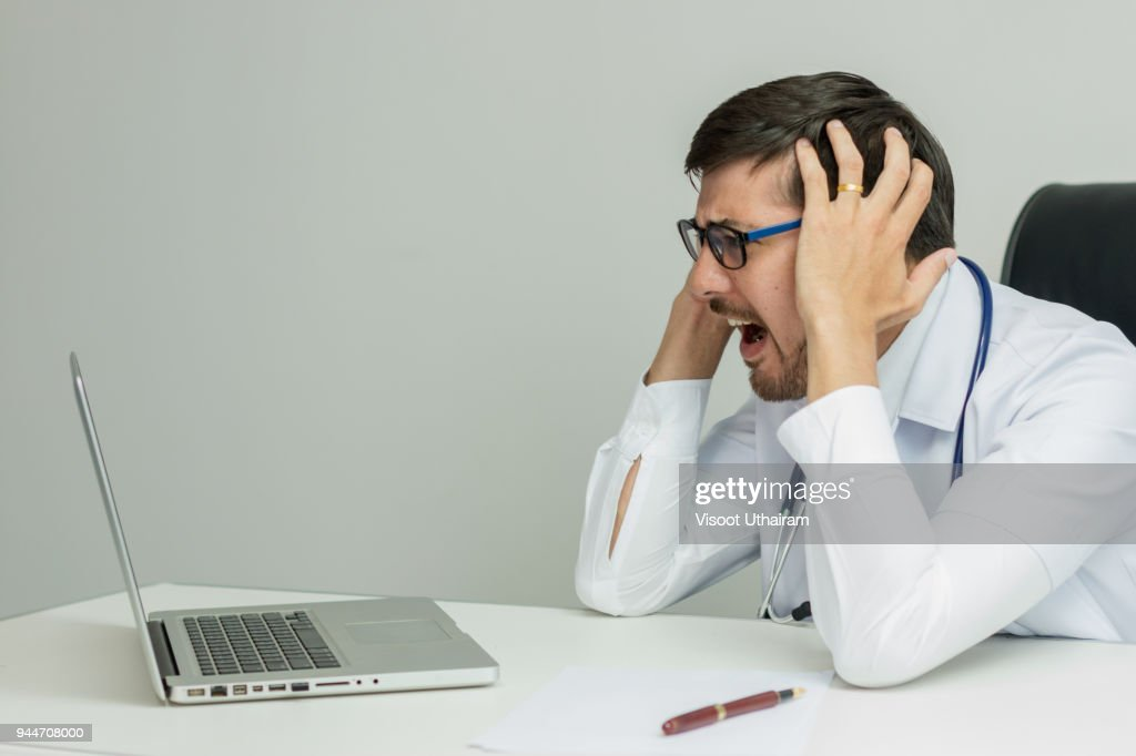 Stressed Senior businessman holding document binders on his head. : Stock Photo