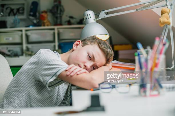 stressed student during home schooling pandemic alert - ホームスクーリング ストックフォトと画像