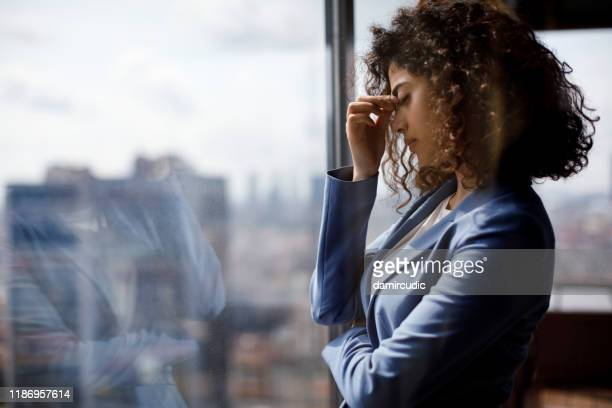 stressed tired businesswoman - burden stock pictures, royalty-free photos & images