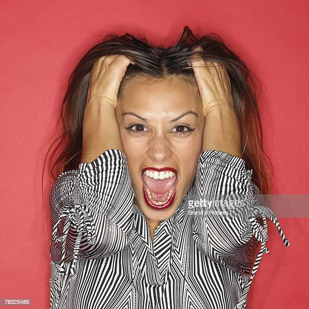 stressed woman - pulling hair stock photos and pictures
