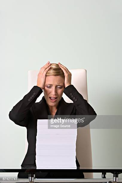 Stressed woman with paperwork