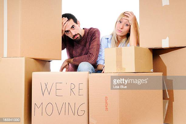 stressed young couple relocation - lisa strain stock pictures, royalty-free photos & images