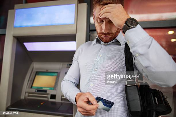 stressful businessman doesn't have enough money on his credit ca - ginger banks stock pictures, royalty-free photos & images