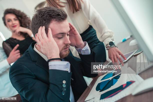 stressful businessman with headache feeling sick from work at busy modern office - aleksandar georgiev stock photos and pictures