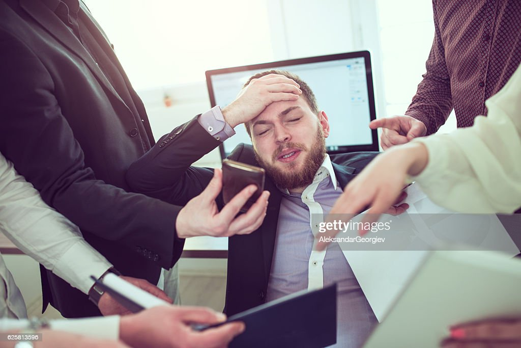 Stressful Businessman with Headache when Receiving Many Complaint and Issue : Stock Photo