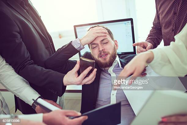 Stressful Businessman with Headache when Receiving Many Complaint and Issue