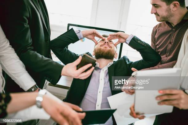stressful businessman with headache when receiving many complaints - surrounding stock pictures, royalty-free photos & images