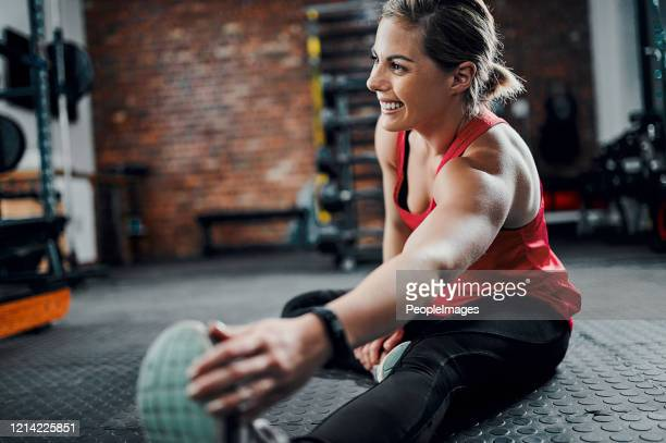 stretch before every workout - warming up stock pictures, royalty-free photos & images