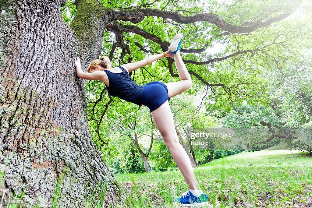 Stretch before running : Stock Photo