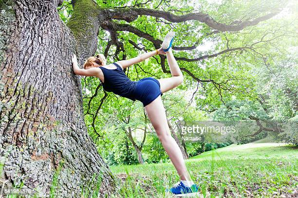 stretch before running - woman open legs stock photos and pictures
