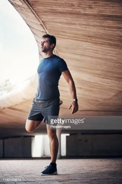 stretch beyond all those excuses - adulto de idade mediana imagens e fotografias de stock