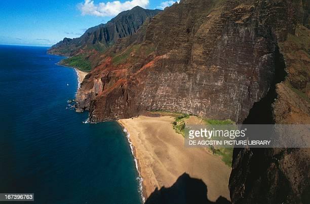 A stretch of beach along the cliffs Na Pali Coast State Wilderness Park Kauai Hawaii United States